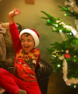 Kids love decorating a Christmas tree just as much as adults. A wonderful Christmas tradition. 2traveldads.com