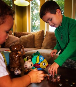 2TD Kids saving with piggy banks
