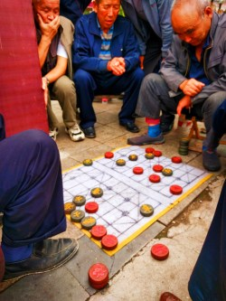 Old Men playing Chinese game in street Baoji China 1