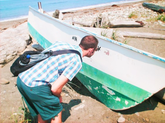 Chris Taylor with abandoned boat at Dungeness Spit