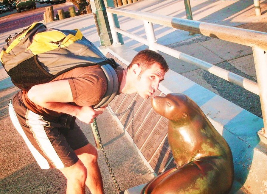Chris Taylor kissing seal statue at Seal Beach Orange County 1