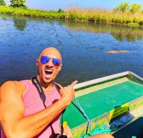 Rob Taylor and alligator on Airboat in Mobile Delta 1