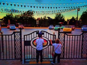 Taylor Family at Luigis Rollickin Roadsters Cars Land at night Disneys California Adventure 2
