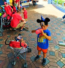 Taylor Family hydrating in Tomorrowland Disneyland 1