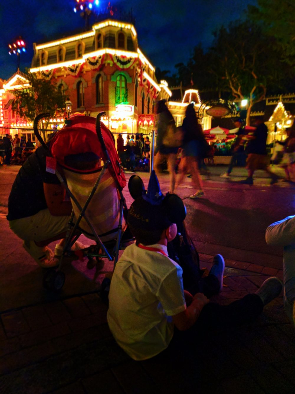 Taylor Family waiting for the Main Street Electrical Parade Disneyland at night 2