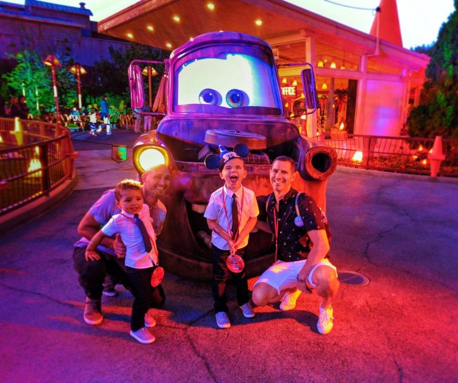 Taylor Family with Mater Cozy Cone Cars Land at night Disneys California Adventure 1