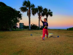 Taylor family playing cornhole at sunsset on Jekyll Island Golden Isles 1