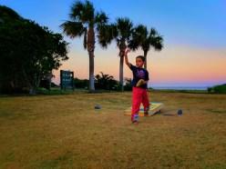 Taylor family playing cornhole at sunsset on Jekyll Island Golden Isles 1