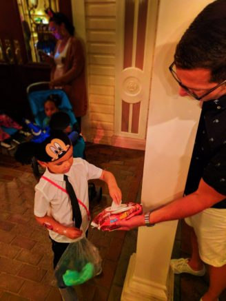 Taylor family with cotton candy Huggies Wipes in Town Square Main Street USA Disneyland KC 1