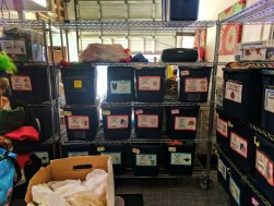 Bins of childrens clothing at WestSide Baby National Diaper Bank Network Huggies 2