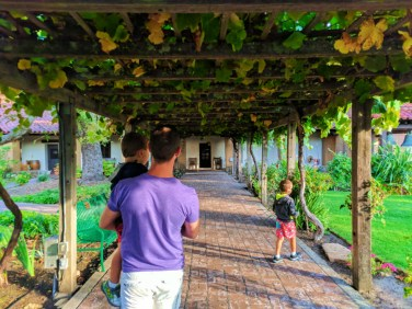 Taylor Family with grape vines at Mission San Luis Obispo 1