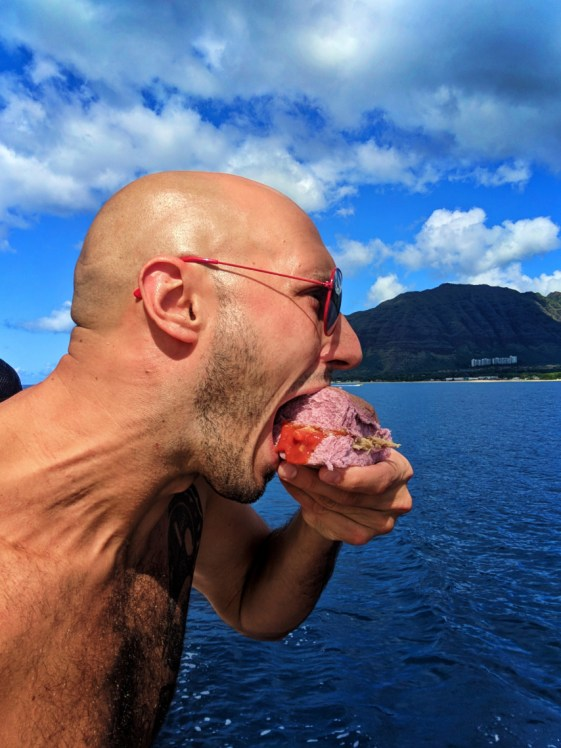 Taylor family eating kaluha pork on poi on catamaran off Oahu 3