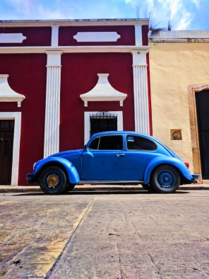 VW Bug and Colorful buildings on sidestreet in Valladolid Yucatan road trip 2d
