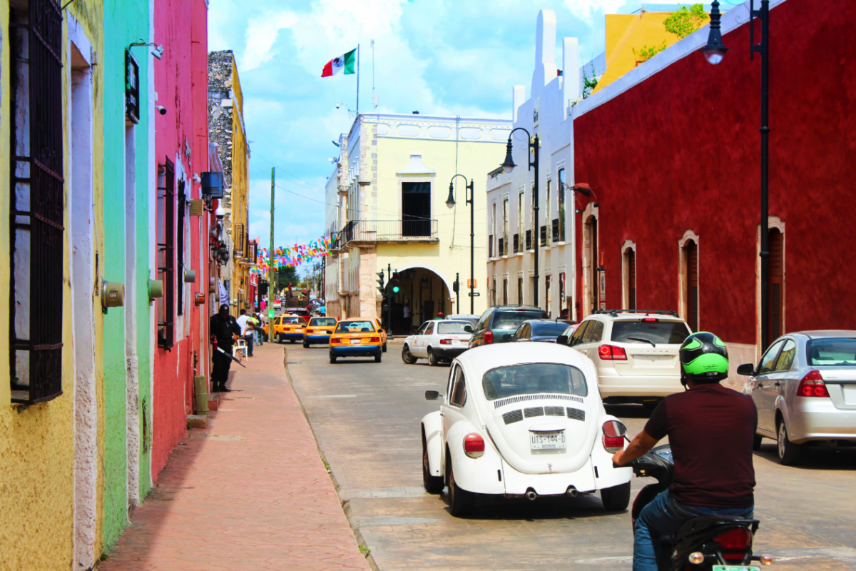 Colorful buildings and VW bug in Valladolid Yucatan road trip 1