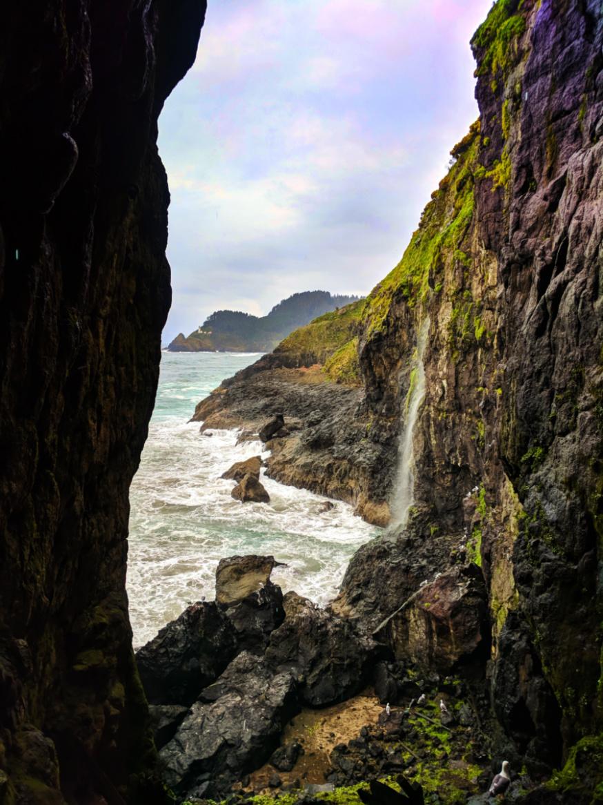 Haceta Head Lighthouse at waterfall at Sea Lion Caves Florence Oregon Coast 2