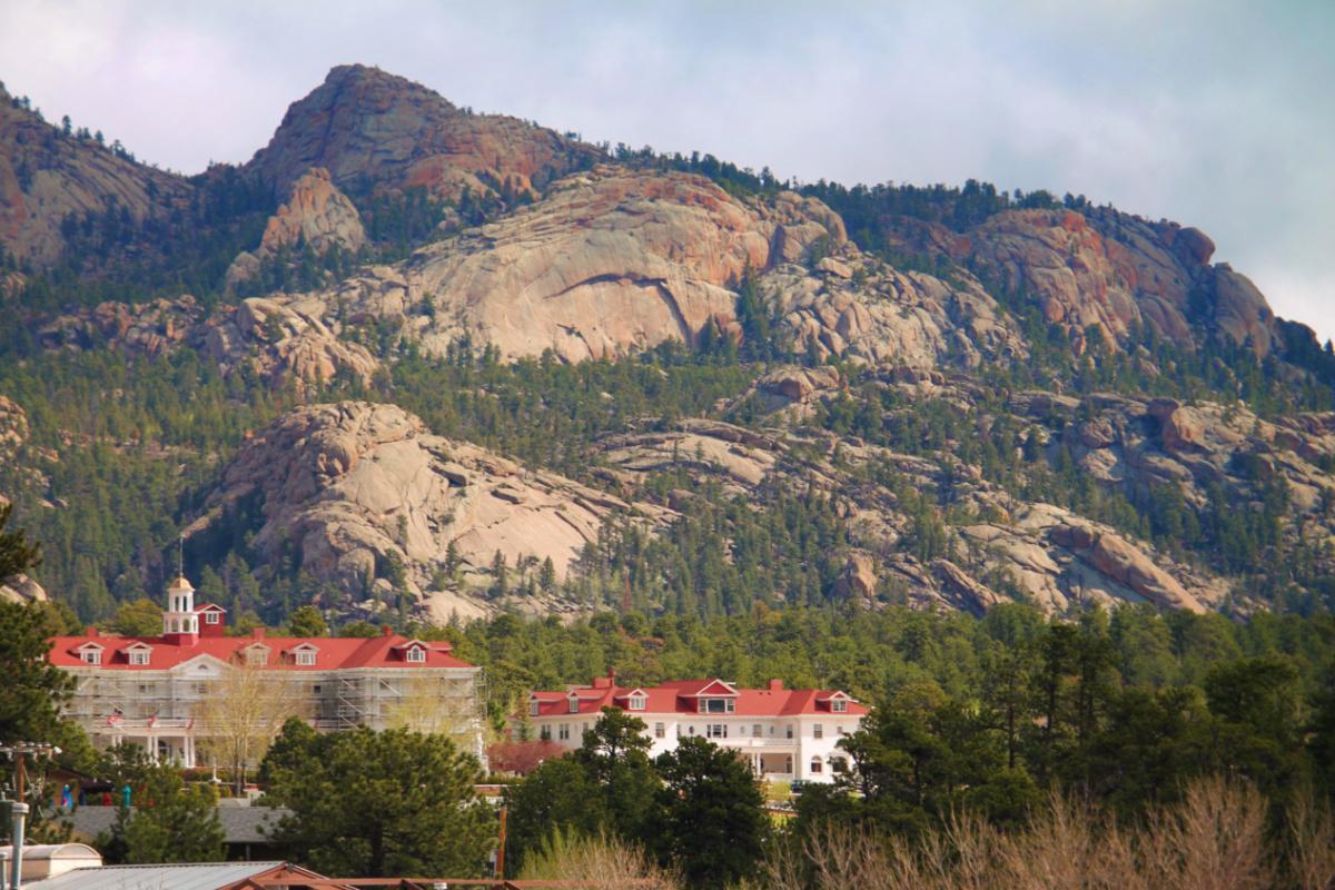 Stanley Hotel with Mountains in Estes Park Colorado 1