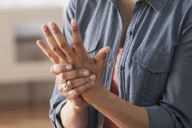 Older-Black-woman-rubbing-her-hands--Arthritis.jpg