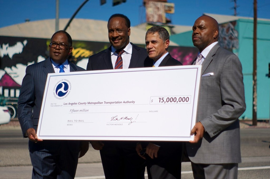 L.A. County Supervisor and Metro Board Chair Mark Ridley-Thomas, Inglewood Mayor and Metro Board Member James Butts, Deputy Secretary of Transportation Victor Mendez, and Metro CEO Phil Washington hold the ceremonial check granted to the Rail-to-River project set to run along Slauson Avenue in South L.A. Sahra Sulaiman/Streetsblog L.A.