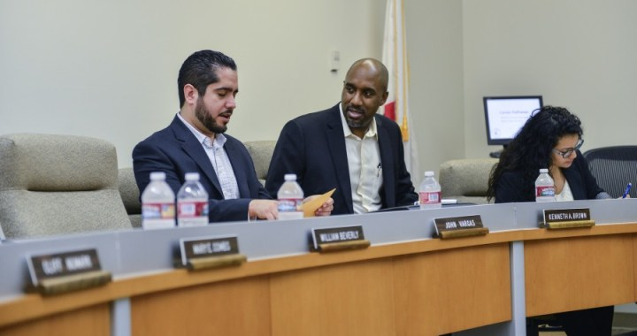 Vargas, left, speaks with fellow trustee member Ken Brown at the board of trustee meeting on Feb. 17 at El Camino. (photo: Tristan Bellisimo)