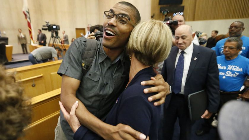 Compton Commissioner Rodney Andrews, left, reacts after county authorities voted unanimously to dissolve the troubled water agency.(Al Seib / Los Angeles Times )