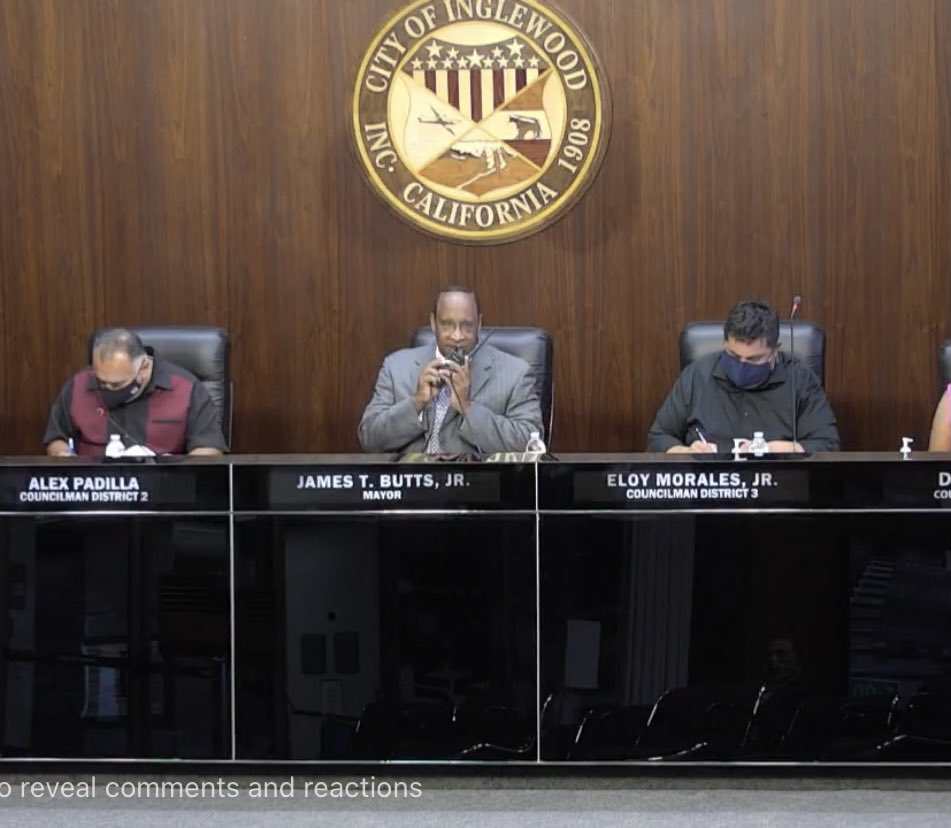 Inglewood Mayor James Butts speaks into police radio during August 10 city council meeting. (Credit: City of Inglewood)