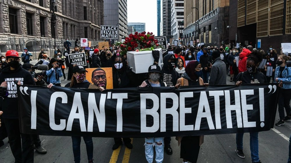 DEMONSTRATORS HOLD PLACARDS DURING THE I CANT BREATHE - SILENT MARCH FOR JUSTICE IN FRONT OF THE HENNEPIN COUNTY GOVERNMENT CENTER IN MINNEAPOLIS ON MARCH 7, 2021.  (PHOTO BY CHANDAN KHANNA/AFP VIA GETTY IMAGES)
