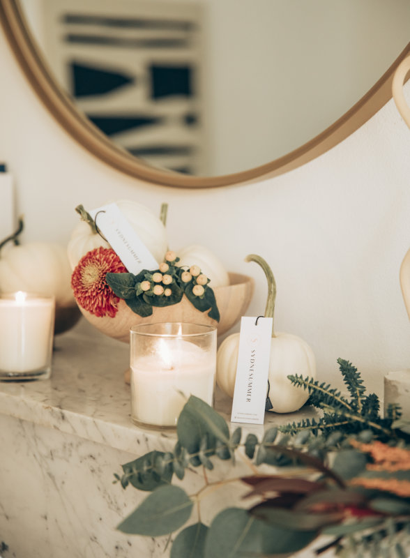 Sydne Style shows easy fall home decor ideas with eucalyptus and candles on fireplace