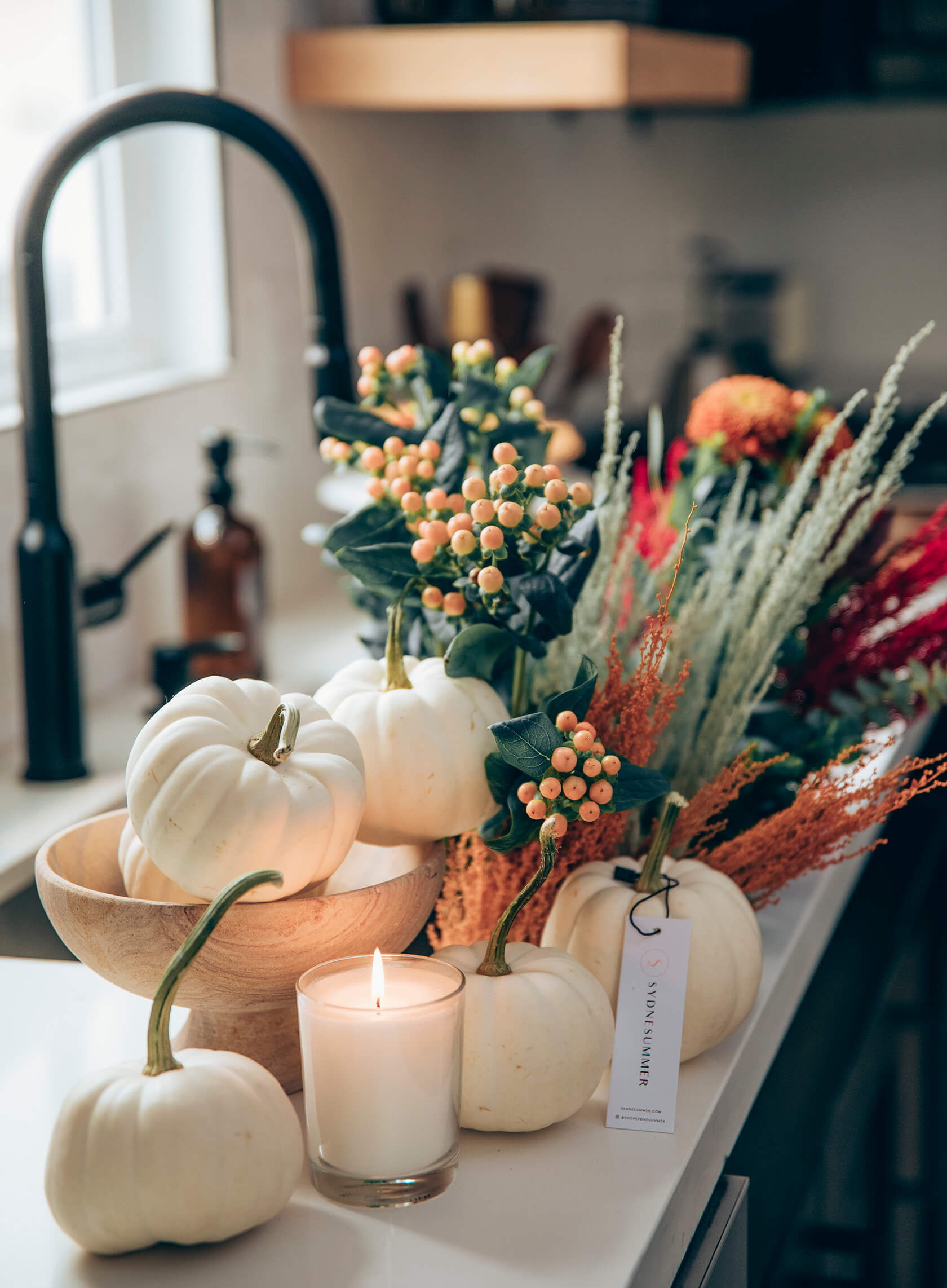 Sydne Style shows easy fall home decor ideas with white pumpkins and fresh flowers