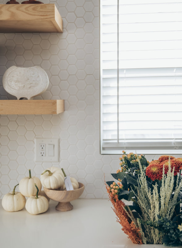 Sydne Style shows minimalist fall home decor ideas with white pumpkins