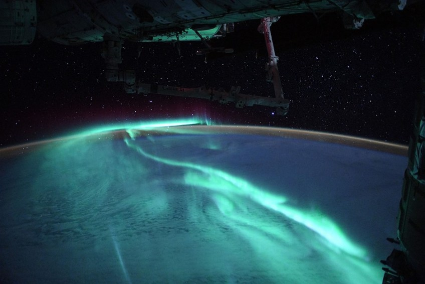 Astronaut captures images of stunning blue auroral display from space