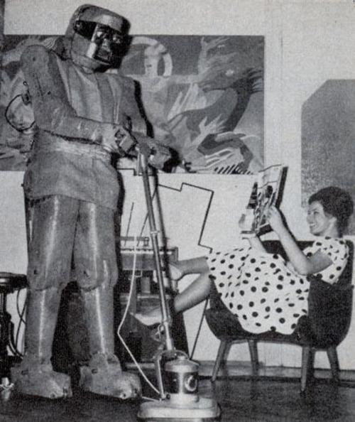 Mechanical servant vacuuming the floor