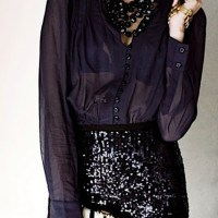Sequin skirt with long sleeved transparent top.
