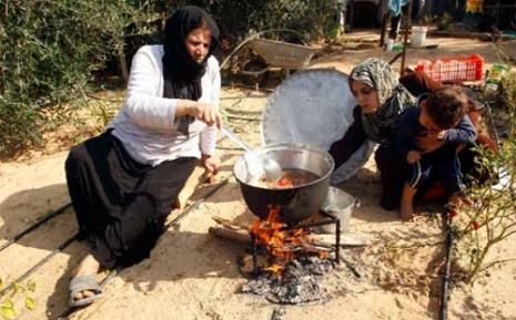 Palestinian family use wood instead of gas for cooking because of the depletion of gas due to Israel's refusal to allow entry of gas because of the Israeli blockade of Gaza.