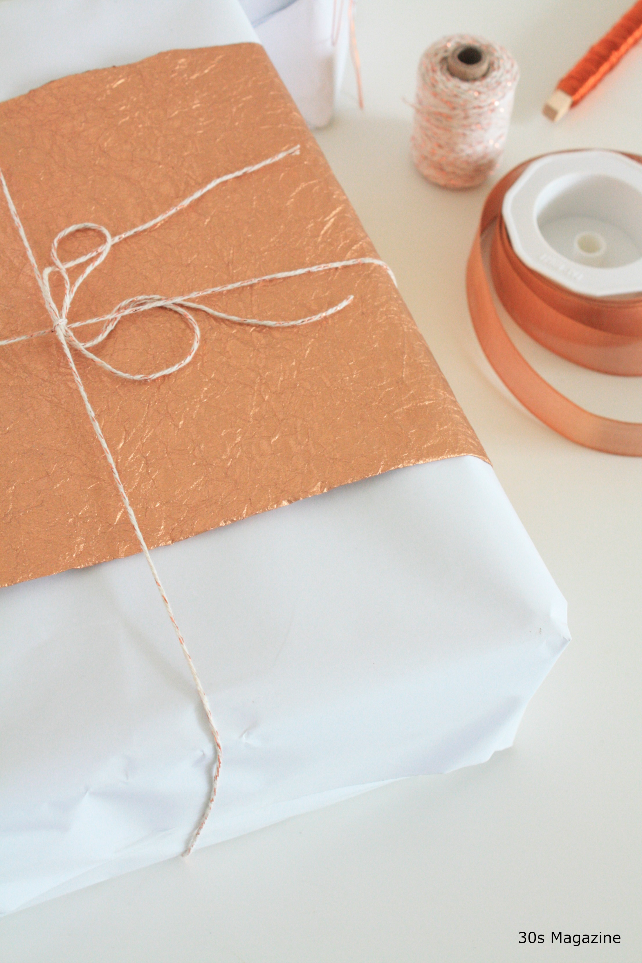 wrapping gifts in copper and white 30s magazine