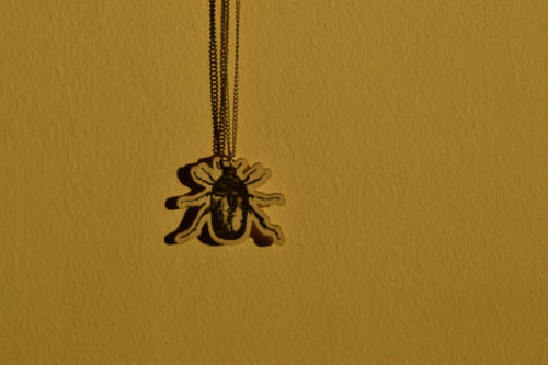 23 inch / 58.5 centimetre silver-coloured metal chain and round closure with upcycled painted wooden beetle pendant.Show off your love of bugs or cheer up the entomophile in your life with this unusual pendant necklace! Lightweight, easy-wearing, great for day wear.Click on image for listing!