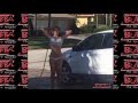 Nikki washing Bubba's car in a bikini