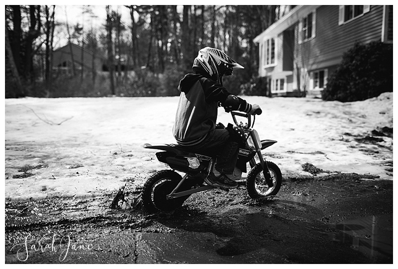 Riding Bikes in the mud during Spring thaw in Maine Family Documentary Photography