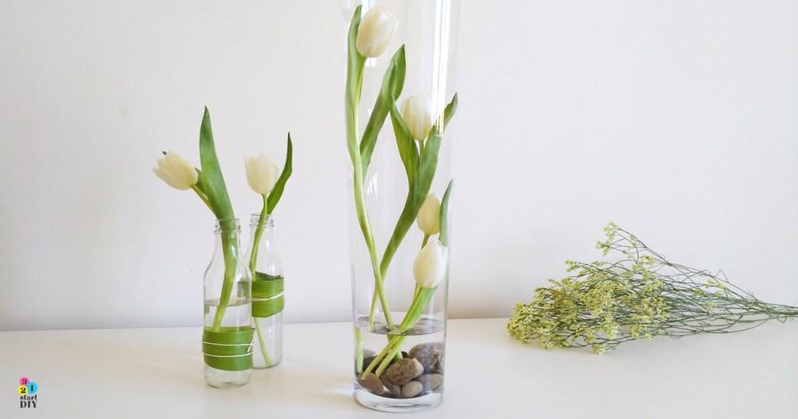 Tulipany w wysokim wazonie - nowoczesne kompozycje kwiatowe