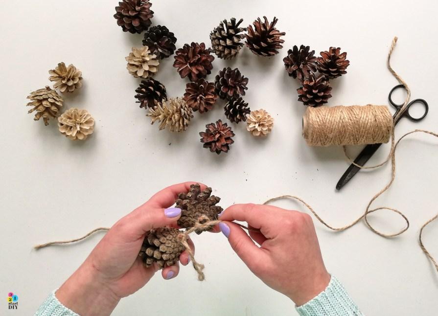 jesienne dekoracje diy - girlanda z szyszek