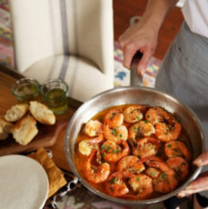 New Orleans Style Shrimp in a buttery sauce in a saucepan.