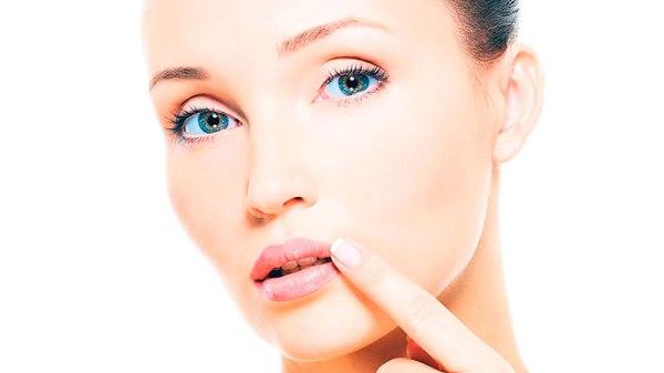 Болячка на губе: виды, причины, фото и методы лечения
