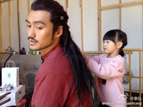 Cindy decorating Yuan Hong's hair