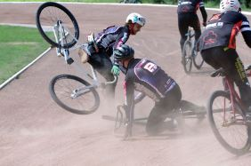 Mason Phillips comes to grief after the luckless Ray Oliver falls in front. Photo by Ray Andrews.
