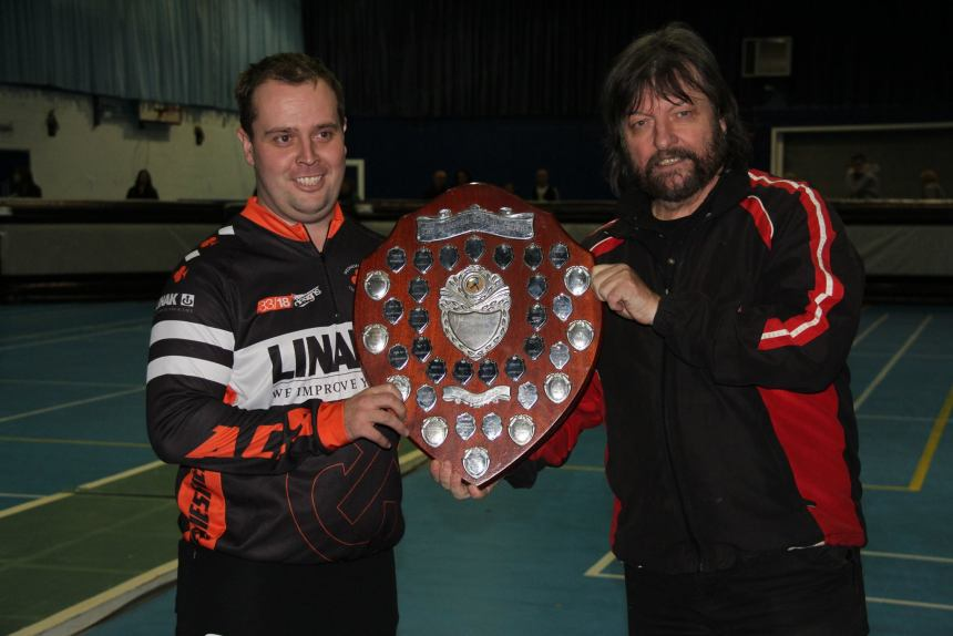 Geoff Gamage (right) pictured presenting the Indoor Team Championship shield to Wednesfield's Chris Jewkes earlier this month. Photos by Andrew Davison.