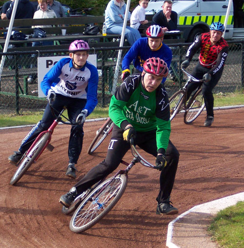 Frank Finnigan (A&T) leading Grzegorz Pawlicki (Rybnik), Steve Ward (Tameside) and Paul Dyson (Bury) in the 2004 Astley & Tyldesley Festival meeting. Photo by Len Priestley.