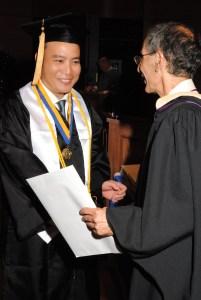 Noel wearing his Golden Key member at his graduation