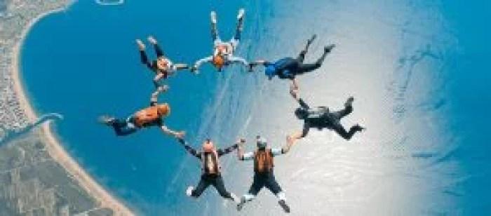 belly formation skydive friends ocean beach sunset summer
