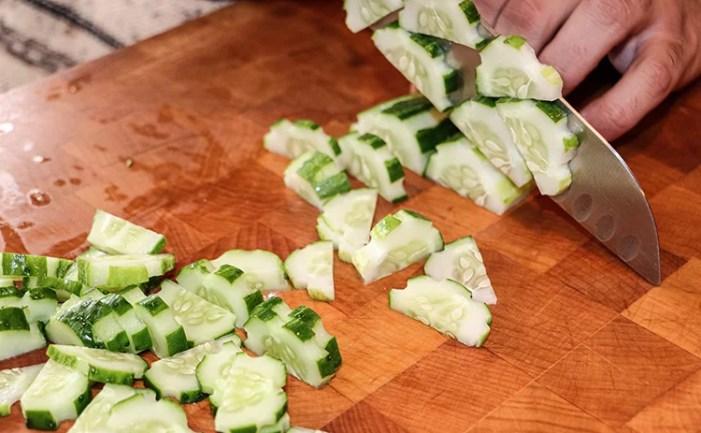 chef cutting cucumber