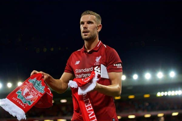 LIVERPOOL, ENGLAND - Tuesday, August 7, 2018: Liverpool's captain Jordan Henderson hands out balls and scarves top supporters after the preseason friendly match between Liverpool FC and Torino FC at Anfield. (Pic by David Rawcliffe/Propaganda)