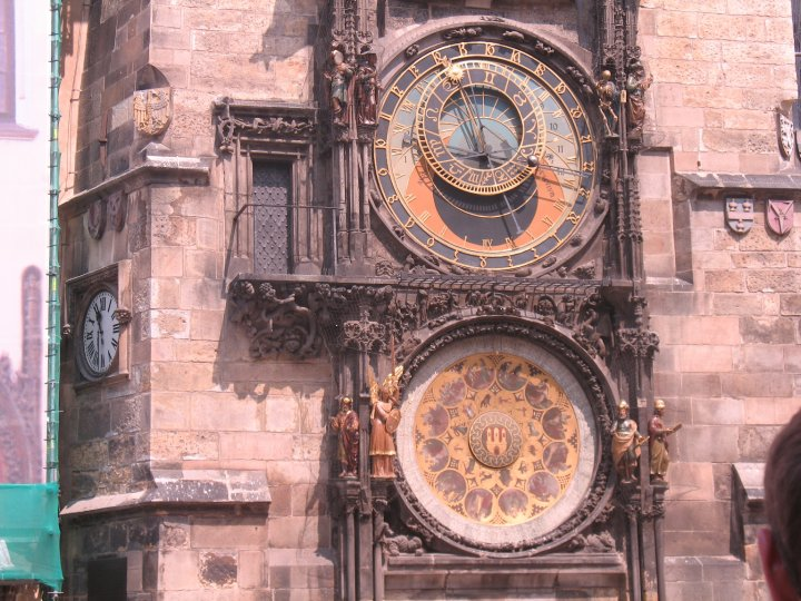 Astronomical clock tower, with the astronomical dial  and clock on the top and the calendar dial on the bottom